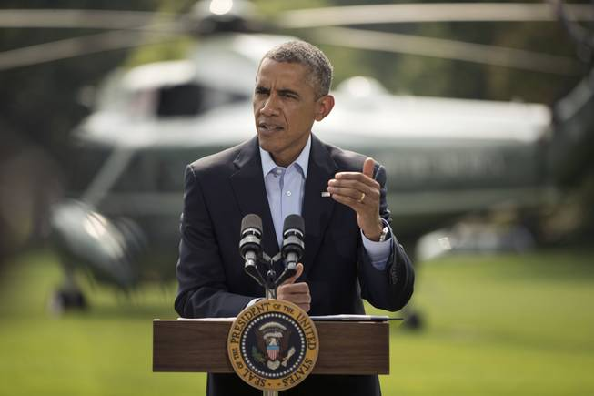 President Barack Obama speaks on the South Lawn of the White House in Washington, Saturday, Aug. 9, 2014, about ongoing situation in Iraq before his departure on Marine One for a vacation in Martha's Vineyard.