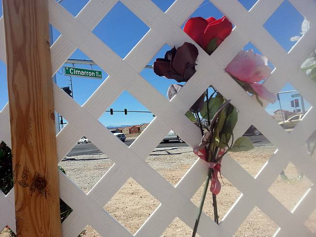When Helen Liu was killed in November, there was no crosswalk at Blue Diamond and Cimarron roads. Flowers at a memorial are seen at the intersection, which also now features a new crosswalk and traffic light, Thursday, Aug. 14, 2014.