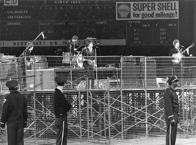 In this photo taken Aug. 29, 1966, The Beatles perform at Candlestick Park in San Francisco. Candlestick Park, known for its bone-numbing winds, the Catch and the earthquake-rocked 1989 World Series, is officially closing after more than a half century of hosting sporting and cultural events.