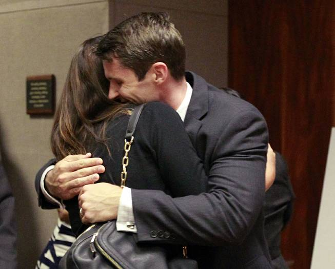 State Department Special Agent Christopher Deedy hugs his wife, Stephanie Deedy, following his acquittal on murder charges Thursday, Aug. 14, 2014, in the November 2011 shooting of a man at a Hawaii fast food restaurant. Jurors couldn't reach a verdict on other, lesser chargers.