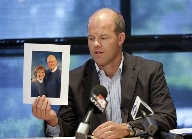 Attorney Paxton Guymon holds a photograph of Jim and Jan Harding during a news conference in Salt Lake City on Thursday, Aug. 14, 2014. Jan Harding, 67, is in critical condition at a Salt Lake City hospital's burn unit, unable to talk and fighting for her life, Guymon said.