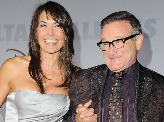 "This Nov. 9, 2009, file photo shows actor Robin Williams and his wife, Susan Schneider, at the premiere of ""Old Dogs"" in Los Angeles."