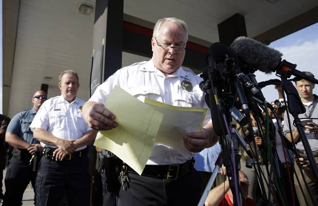 Ferguson Police Chief Thomas Jackson releases the name of the the officer accused of fatally shooting Michael Brown, an unarmed black teenager, Friday, Aug. 15, 2014, in Ferguson, Mo. Jackson announced that the officer's name is Darren Wilson.