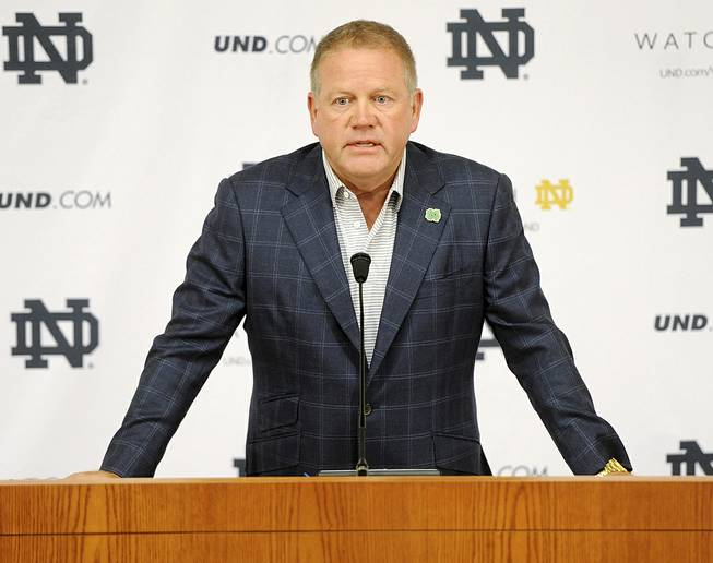 "In this Aug. 1, 2014, file photo, Notre Dame football coach Brian Kelly talks to the media at the beginning of fall practice in South Bend, Ind. Notre Dame says it is investigating ""suspected academic dishonesty"" involving several students, including four members of the football team."