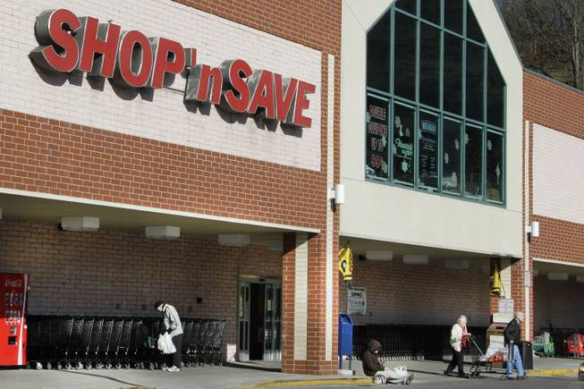 In this Jan. 9, 2012, file photo, customers exit a Shop' Save grocery store in Mount Lebanon, Pa. Supervalu said Friday, Aug. 15, 2014, that a potential data breach may have impacted about 200 of its stores and reached stores it sold off last year.