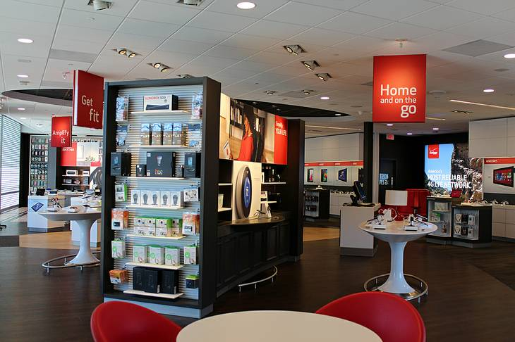 Products are shown at a Verizon Wireless Smart Store.