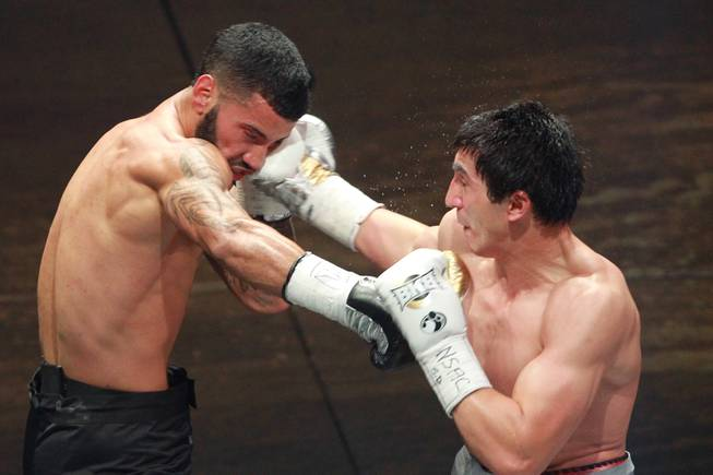 Khurshid Abdullaev hits Ricardo Pinell with a right during their fight on the inaugural card of Big Knockout Boxing Saturday, Aug. 16, 2014 at the Mandalay Bay Events Center. Abdullaev won by unanimous decision.