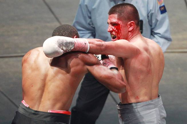 Javier Garcia hits Darnell Jiles with a left during their fight on the inaugural card of Big Knockout Boxing Saturday, Aug. 16, 2014 at the Mandalay Bay Events Center. Garcia won by TKO in the fifth round.