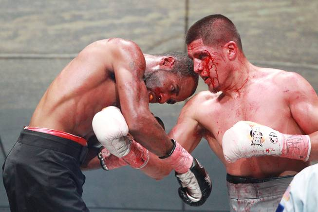 Javier Garcia hits Darnell Jiles with a right during their fight on the inaugural card of Big Knockout Boxing Saturday, Aug. 16, 2014 at the Mandalay Bay Events Center. Garcia won by TKO in the fifth round.