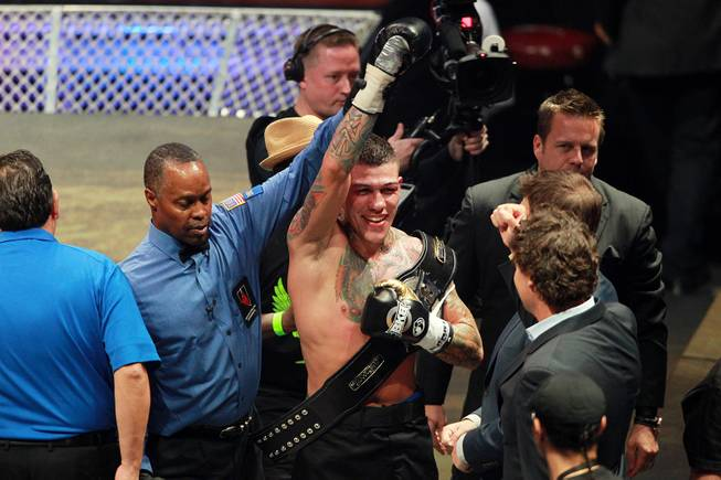 Gabe Rosado has his arm raised after his sixth round TKO Bryan Vera during their fight on the inaugural card of Big Knockout Boxing Saturday, Aug. 16, 2014 at the Mandalay Bay Events Center.