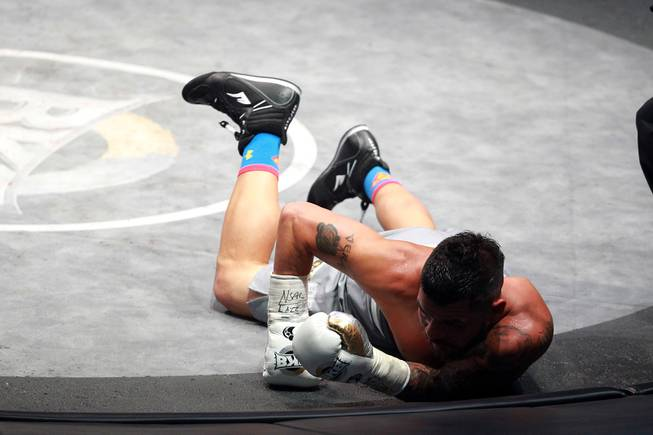 Bryan Vera hits the mat after being knocked down by Gabe Rosado during their fight on the inaugural card of Big Knockout Boxing Saturday, Aug. 16, 2014 at the Mandalay Bay Events Center. Rosado won by TKO.