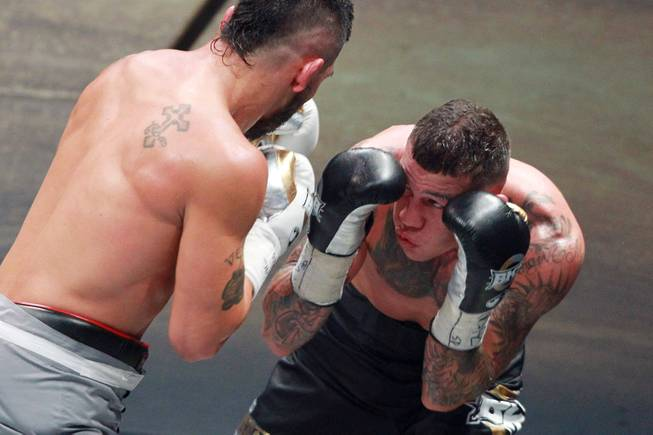 Gabe Rosado looks for an opening on Bryan Vera during their fight on the inaugural card of Big Knockout Boxing Saturday, Aug. 16, 2014 at the Mandalay Bay Events Center. Rosado won by TKO.