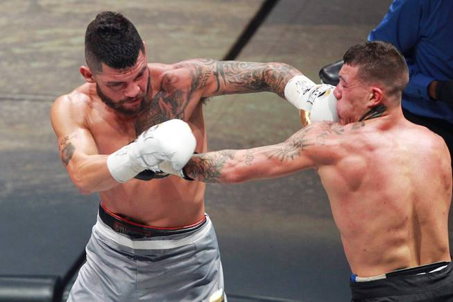 Gabe Rosado gets hit by Bryan Vera during their fight on the inaugural card of Big Knockout Boxing Saturday, Aug. 16, 2014 at the Mandalay Bay Events Center. Rosado won by TKO.