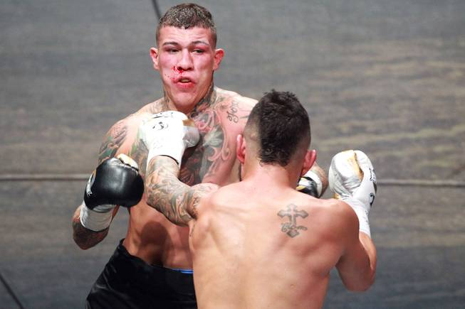 Gabe Rosado backs away from Bryan Vera during their fight on the inaugural card of Big Knockout Boxing Saturday, Aug. 16, 2014 at the Mandalay Bay Events Center. Rosado won by TKO.