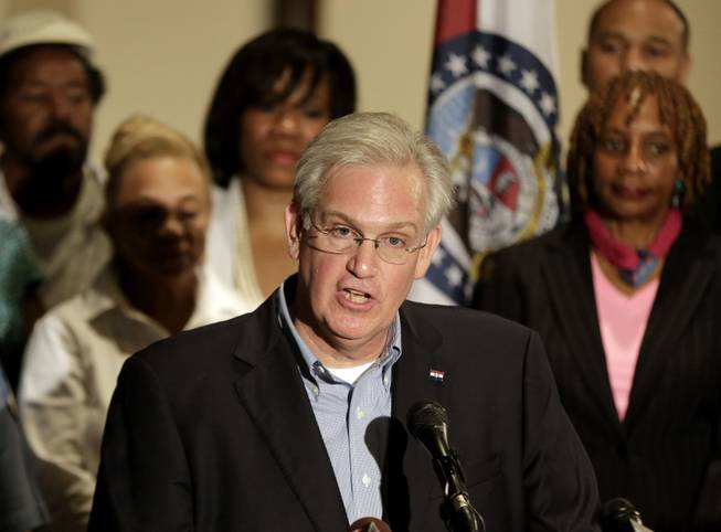 Missouri Gov. Jay Nixon speaks at a news conference dealing with the aftermath of a police shooting of teenager Michael Brown, Saturday, Aug. 16, 2014, in Ferguson, Mo. The governor declared a state of emergency Saturday and imposed a curfew in the St. Louis suburb where police and protesters have clashed after Brown was shot to death by a white police officer a week ago.