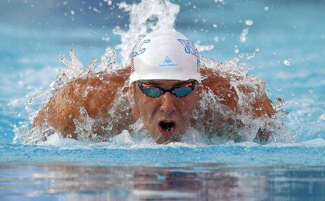 In this Sunday, Aug. 10, 2014, photo, Michael Phelps swims the butterfly in the men's 200-meter individual medley final at the U.S. nationals of swimming in Irvine, Calif.