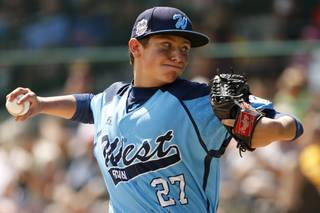 Las Vegas pitcher Brennan Holligan (27) delivers during the first inning of a baseball game against Chicago at the Little League World Series tournament in South Williamsport, Pa., Sunday, Aug. 17, 2014.