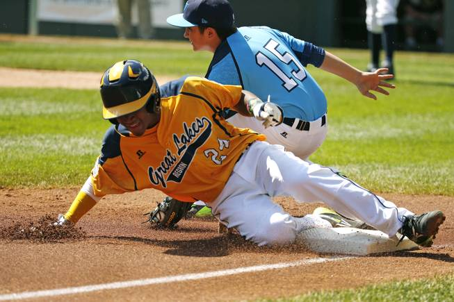 Chicago's Trey Hondras (24) steals third ahead of the tag by Las Vegas third baseman Dillon Jones (15) during the first inning of a baseball game in United States pool play at the Little League World Series tournament in South Williamsport, Pa., Sunday, Aug. 17, 2014.