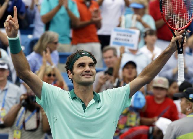 Roger Federer celebrates after defeating David Ferrer 6-3, 1-6, 6-2 in a final match at the Western and Southern Open tennis tournament Sunday, Aug. 17, 2014, in Mason, Ohio.