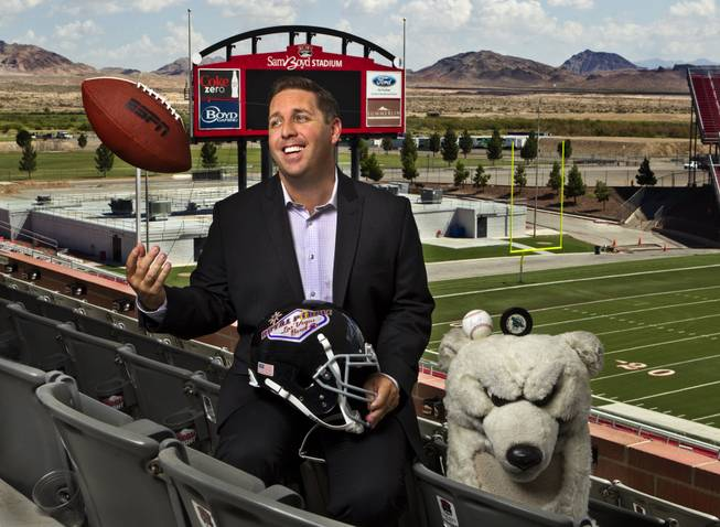 John Saccenti, the new executive director of the Royal Purple Las Vegas Bowl, kicks back at Sam Boyd Stadium on Thursday, Aug. 14, 2014. He's been working in sports in Las Vegas for the past 16 years, starting out as the mascot for the Las Vegas Thunder hockey team and working his way up.