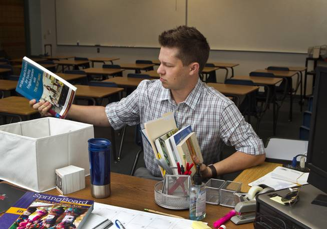 Cody Phillips begins to prepare for his first-year as a full time CCSD teacher at Del Sol High School on Monday, August 18, 2014.