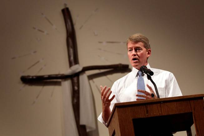 "Missouri Attorney General Chris Koster, right, speaks at the Greater St. Mark Family Church in Ferguson, Mo. on Sunday Aug. 17, 2014. ""A member of your community died at the hands of a member of my community,"" Koster said. ""Not just the caucasian community but the law enforcement community."" On Saturday, Aug. 9, 2014, a white police officer fatally shot Michael Brown, an unarmed black teenager, in the St. Louis suburb."