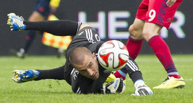 Montreal Impact goalkeeper Evan Bush keeps his eyes on the ball as Chicago Fire's Mike Magee (9) moves in during the first half of a Major League Soccer game Saturday, Aug. 16, 2014, in Montreal. Findlay Sports and Entertainment is proposing building a stadium and bringing an MLS franchise to Symphony Park in downtown Las Vegas.