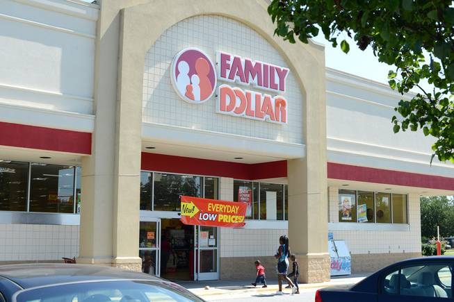In this Tuesday, July 29, 2014, photo, customers enter a Family Dollar store on Plaza Boulevard in Kinston, N.C. There's now a bidding war for Family Dollar, with Dollar General offering about $9.7 billion for the discounter in an effort to trump Dollar Tree's bid of $8.5 billion.