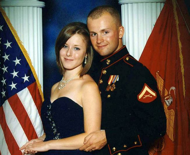 This undated file photo shows Erin Corwin, left, with her husband, Jonathan Wayne Corwin, a corporal in the U.S. Marine Corps. Erin Corwin disappeared after leaving her home on the Twentynine Palms Marine Corps base June 28, 2014.
