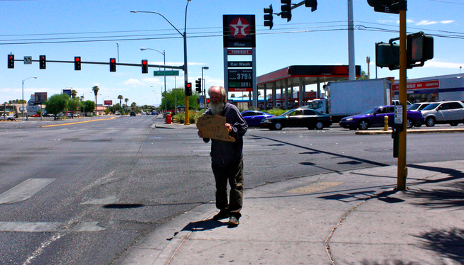 Paul, who says he doesn't have a last name, stands near Maryland Parkway and Tropicana Avenue on Friday, July 25, 2014, in Las Vegas.