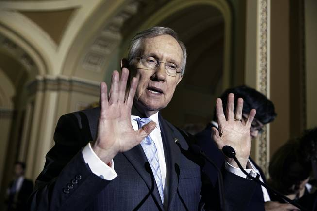 Senate Majority Leader Harry Reid speaks to reporters on Capitol Hill in Washington, July 15, 2014. Reid said Monday, Aug. 18, that he won't be spending time — or money — assisting the campaign of Nevada Democratic gubernatorial candidate Bob Goodman.