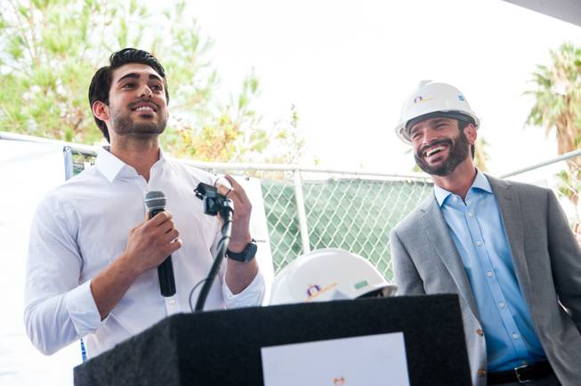 Guiseppe Pizano (left), a former homeless youth and NPHY beneficiary, shares his story of homelessness and how he received assistance through NPHY while Arash Ghafoori, NPHY executive director, listens.  Pizano subsequently graduated from high school and is now attending college and working.