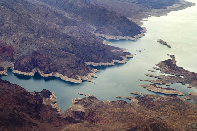 "A view of the white ""bathtub"" ring around Lake Mead indicates the drop in water level through the years from the lake's high point."