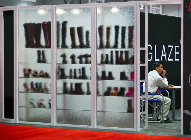 Boots and shoes with Glaze are on display and seen through glass during the MAGIC Marketplace Fall Show at the Las Vegas Convention Center on Tuesday, August 19, 2014.  L.E. Baskow
