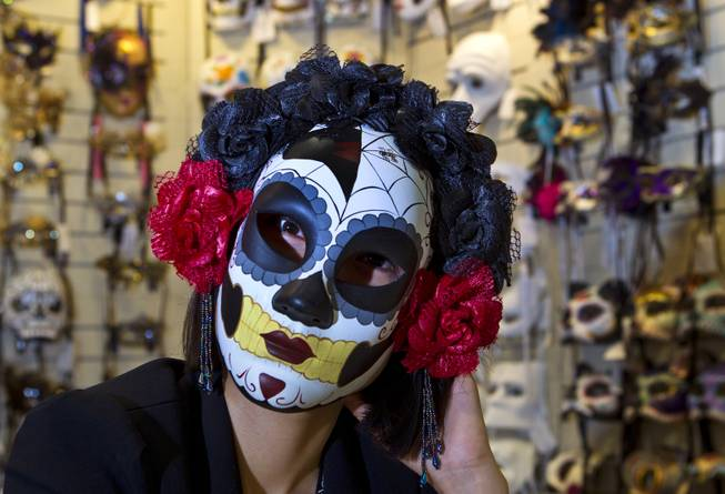 Joy Pan wears one of her dynamic masks from the KBW Global Corp. during the MAGIC Marketplace Fall Show at the Las Vegas Convention Center on Tuesday, August 19, 2014.
