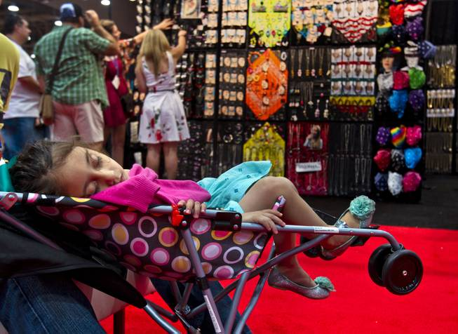 Valeria Reyes, 1, takes an afternoon nap during the MAGIC Marketplace Fall Show at the Las Vegas Convention Center on Tuesday, August 19, 2014.