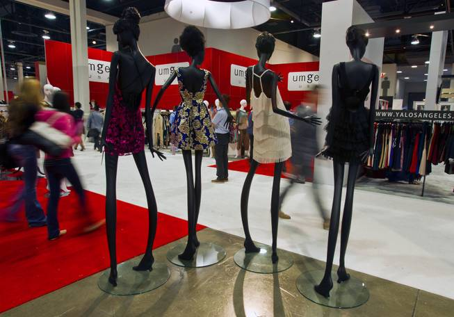 New dresses with Ark & Co. adorn extra tall and thin mannequins during the MAGIC Marketplace Fall Show at the Las Vegas Convention Center on Tuesday, August 19, 2014.