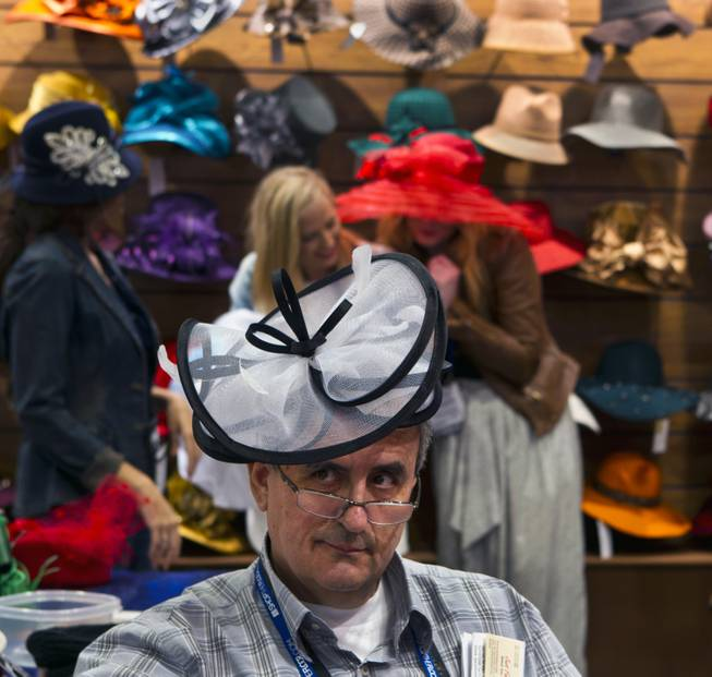 Attendee Peter Kaklamanakis wears a hat from Something Special during the MAGIC Marketplace Fall Show at the Las Vegas Convention Center on Tuesday, August 19, 2014.