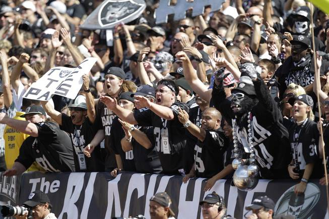 Oakland Raiders fans in the Black Hole cheer during the first quarter of their NFL football game against the New England Patriots in Oakland, Calif., Sunday, Oct. 2, 2011.