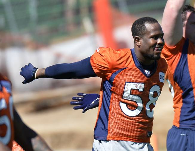 Denver Broncos' Von Miller stretches during an NFL football organized team activity, Wednesday, May 28, 2014, in Englewood, Colo.
