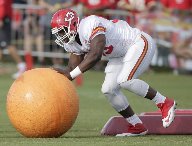 Kansas City Chiefs linebacker Justin Houston (50) participates in a drill during NFL footballtraining camp Sunday, July 27, 2014, in St. Joseph, Mo.