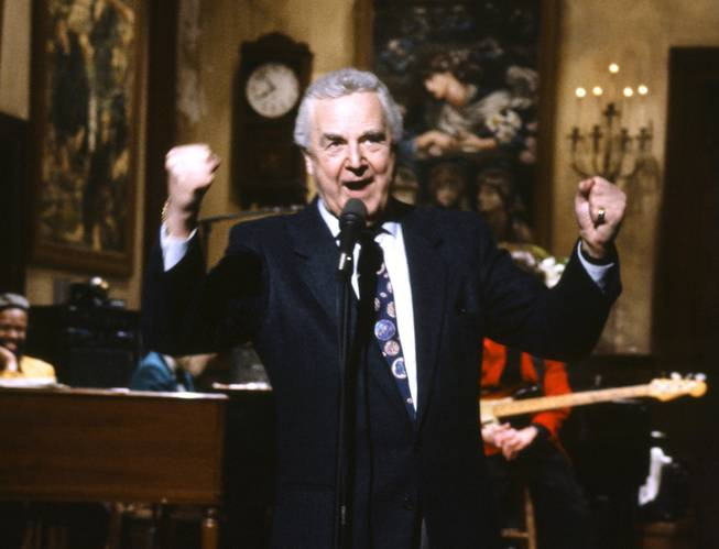 "This March 14, 1992, file photo provided by NBC shows announcer Don Pardo on the set of ""Saturday Night Live."" Pardo, the durable TV and radio announcer whose resonant voiceover style was widely imitated and became the standard in the field, died Monday, Aug. 18, 2014, in Arizona. He was 96."