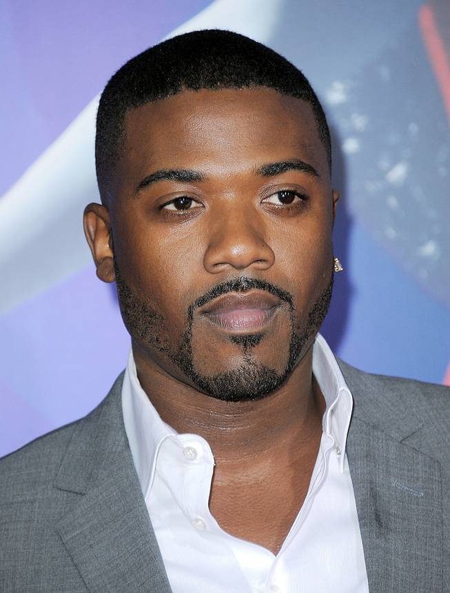 "In this Aug. 16, 2014, file photo, Ray J attends the Los Angeles premiere of ""Sparkle"" at Grauman's Chinese Theatre in Los Angeles. On Tuesday, Aug. 19, 2014, the singer pleaded not guilty to groping a woman at a Beverly Hills hotel bar and resisting arrest afterward."