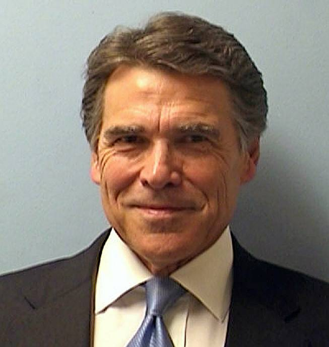 This image provided by the Austin Police Department shows Texas Gov. Rick Perry while being booked at the Blackwell-Thurman Criminal Justice Center in Austin, Texas, for two felony indictments of abuse of power on Tuesday, Aug. 19, 2014, in Austin, Texas.
