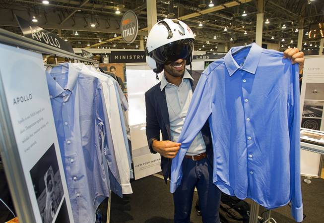 Gihan Amarasiriwardena models a flight helmet as he shows off the Apollo line of shirts at the Ministry of Industry booth during the Modern Assembly fashion trade show at the Sands Expo & Convention Center Wednesday, Aug. 20, 2014. The shirts incorporate NASAs Phase Change Materials to help regulate temperature, absorbing heat away from your skin when you are overheated and releasing it back when you need it. The show is a collection of six shows: The Accessories Show, Agenda, Capsule, Liberty, Mrket, and Stitch.