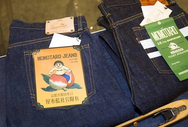 Momotaro (Peach Boy) Jeans are displayed during the Modern Assembly fashion trade show at the Sands Expo & Convention Center Wednesday, Aug. 20, 2014. The jeans take their name from a popular Japanese folktale because  the folktale is believed to have originated in Okayama, Japan where the company is based. The show is a collection of six shows: The Accessories Show, Agenda, Capsule, Liberty, Mrket, and Stitch.