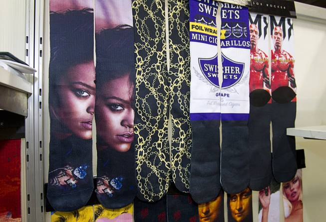 Socks featuring the image of Rihanna are displayed at the Sox Rocker booth during the Modern Assembly fashion trade show at the Sands Expo & Convention Center Wednesday, Aug. 20, 2014. The show is a collection of six shows: The Accessories Show, Agenda, Capsule, Liberty, Mrket, and Stitch.