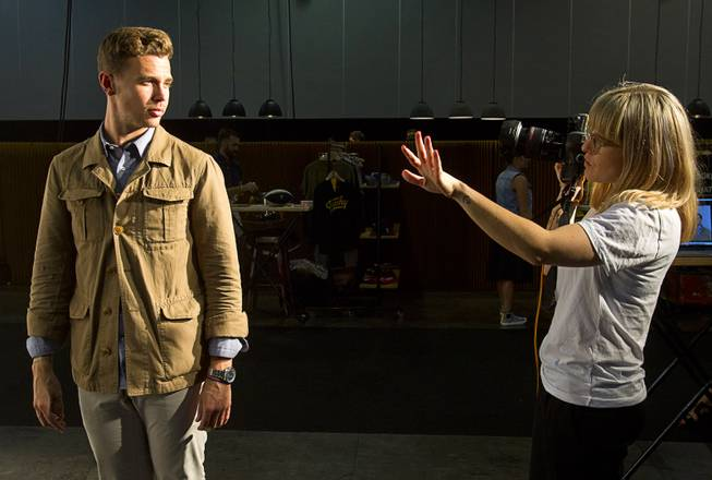 Chase Richardson, a sales manager with Boglioli men's wear, takes direction from South African photographer Kristin Lee Moolman during photo shoot at the Modern Assembly show in the Sands Expo & Convention Center Wednesday, Aug. 20, 2014. The show is a collection of six shows: The Accessories Show, Agenda, Capsule, Liberty, Mrket, and Stitch.
