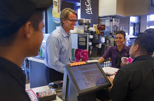 James Vance, owner-operator of eight local McDonald's franchises, chats with employees in his McDonald's at 6990 S. Rainbow Blvd. Wednesday, Aug. 20, 2014. Vance is also president of the Greater Las Vegas McDonalds Owner Operators Association. Since 1999, the local effort has awarded more than $3.1 million in Ronald McDonald House Charities scholarships, helping more than 1,300 Southern Nevada high school students.