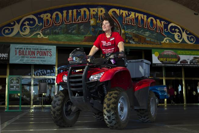 Boulder Station employee Pat Hadlett atop her ATV which she loves to ride when not a guest services ambassador for slots on Friday, August 15, 2014.  She is pleased to be helping the casino in celebrating its 20th year anniversary.